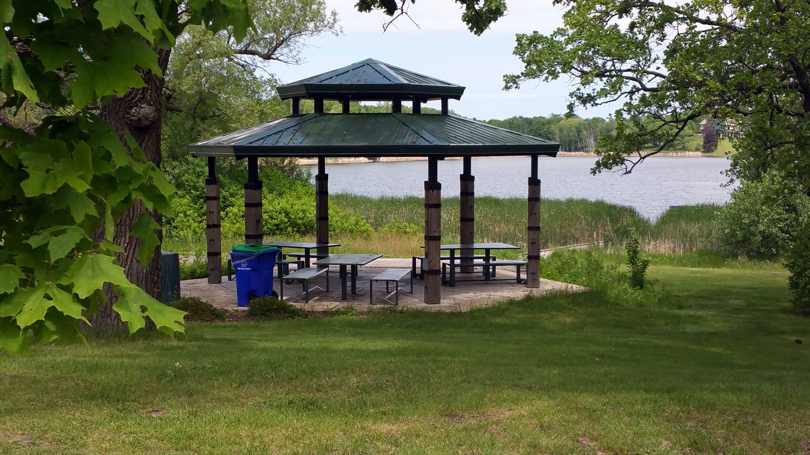 Sunfish Lake Park Shelter has several tables at it. Number of tables can vary. Great view of the wat